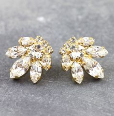 Bridal Crystal Cluster Earrings Get a sparkly look with Our Signature Swarovski Crystal Crystal Cluster Earrings, faceted for extra shine in a delicious