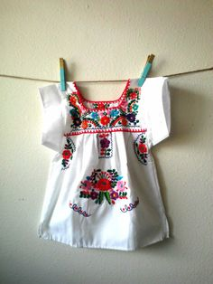 Whitesize: 9 months to 12 months Traditional Puebla Mexican DressHandmade Embroidered Each dress has a unique pattern and colors embroider Light weight CottonMade to be worn loose and at least knee length