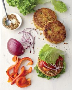 This veggie burger is dense and tasty on a lettuce wrap with mustard.