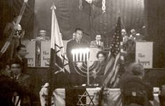 Cham, Germany, Lighting Hanukkah candles in the DP camp, 1945