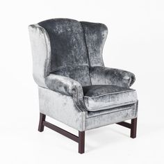 Eilidh Wingback Lounge Chair - This traditionally styled highback armchair is upholstered in a soft, plush, shimmering velvet. Padded and from top to bottom, this lounge chair's rounded and sloping design is the perfect mix of sophistication and class.  http://www.franceandson.com/eilidh-wingback-lounge-chair.html