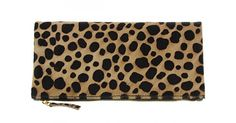 A rectangular shaped pony hair fold over clutch. This cheetah printed clutch has a zip entry into the main compartment, inside includes a zip pocket. Can also be worn unfolded.  Folded: Length: 29.5cm Width: 1cm   Height: 15.5cm  Unfolded  Length: 29.5cm Width: 1cm Height: 27.5cm