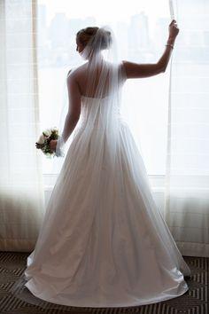 Madeleine's Daughter Bridal Shop — #Madeleine'sDaughterMoment, real bride, real wedding, bridal gown, wedding gown, Paloma Blanca, ivory, fur wrap, veil, winter wedding