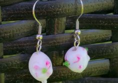 This gorgeous set of earrings features a small floral pattern on a white bead, small and delicate for all occasions, from a summer picnic to