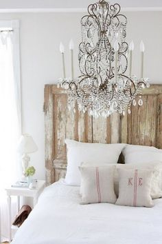 Romantic Bedroom with Chic Chandelier and Weathered Rustic Headboard
