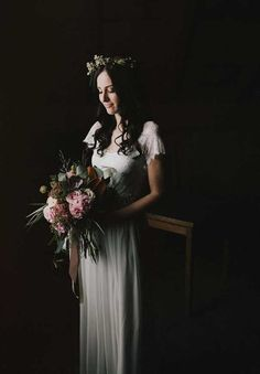 Dark and moody window lit bridal portrait