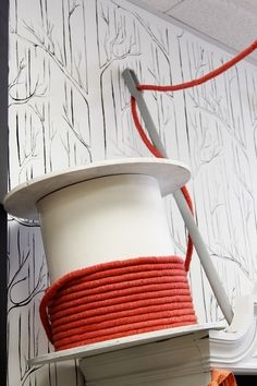 Giant spool of thread and needle. Good display prop for a craft fair booth selling sewn goods