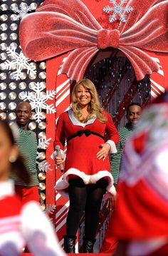 "Pin for Later: Nobody Does Christmas Quite Like Mariah Carey  In 2010, a pregnant Mariah performed ""Oh Santa"" and ""All I Want For Christmas Is You"" at Disney's Magic Kindgom in Florida."