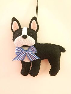 This is a Boston Terrier ornament. This ornament makes a great gift for someone who loves Boston Terriers. He is designed and handmade by me! He is 4 1/2 inches long and lightly stuffed. Find more cute felt ornaments here