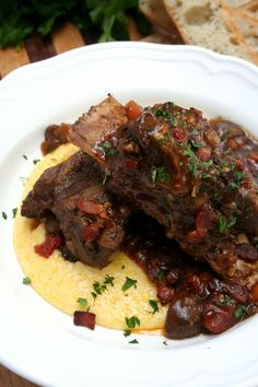 Guinness Braised Short Ribs, did not use the bacon,used mashed potatoes instead of polenta, just as good. Used a little rosemary too. Braised Short Ribs, Beef Short Ribs, Beef Ribs, Dutch Oven Recipes, Beef Recipes, Cooking Recipes, Recipies, Atkins Recipes, One Pot Dishes