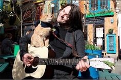 Bob the cat and James Bowen...the stray moggy that saved Jame's life..