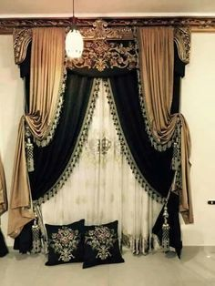Old World formal draperies. layered black and gold with tassel trim and tassel tiebacks