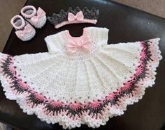 White, pink and gray crochet baby dress set.
