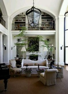 always wanted a living area that was open to a second floor hall lined in book shelves