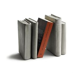 Tove Admans bookrest in concrete is a stylish and sturdy bookrest that fits perfectly between a shelfs books and binders. The bookrests design is fun, functional and has the shape of books and therefore creates an ideal decorative element.