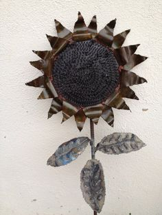Metal sculpture of a sunflower with coiled center. on Etsy, $125.00