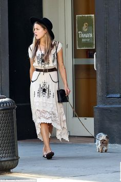 Stylish! The makeup free star looked bohemian chic in a pretty white lace dress, matching...