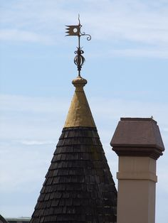Cupola with an antique weather vane and lightning rod