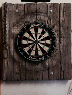 A customer desired a cool back for his dart board. Found it with one of our old barn doors!