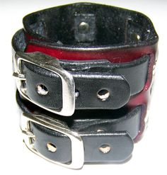 Eastern Oregon Leather Co. - Leather Wrist Cuff Bracelet Deep Red and Black 2 Inches Wide, $32.95 (http://www.easternoregonleather.com/products/Leather-Wrist-Cuff-Bracelet-Deep-Red-and-Black-2-Inches-Wide.html/)
