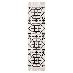"Black/White Classic Accent Rug (1'10""X7') from Nate Berkus. This patterned runner rug uses contrasting black and white with soft fringe accents."