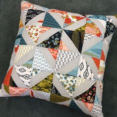 Who doesn't love a great pillow? This was made with a charm pack of Nomad by Urban Chiks and a Fiesta Woven for the background. The pattern is adapted from Bohemian Rhapsody in Country Girl Modern by Jo Kramer and Kelli Hanken. Quilted washed and finished. #ShowMeTheModa #ModaFabrics by modafabrics