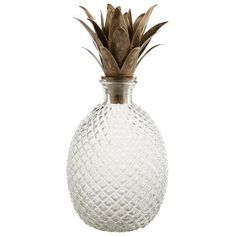 This will freshen up your bar cart. A brilliant, handcrafted decanter, rendered in the classic pineapple shape and topped dramatically with metal leaves. It's truly a work of art, as no two are exactly alike. A real show-stopper when serving wine, it's also a beautiful way to show off infused vodkas, flavored rums or spring water.