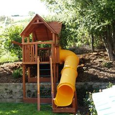 Custom Woodplay Playhouse XL 6 foot deck on a hill. Kids Indoor Playhouse, Outside Playhouse, Backyard Playhouse, Build A Playhouse, Backyard Playground, Playground Ideas, Modern Playhouse, Sloped Yard, Sloped Backyard