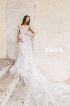 Wedding dress Aureli by Rara Avis. Sleeveless A-line embellished bodice wedding dress with train. Ship worldwide. Based in Vancouver, Canada.