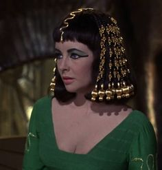Cleopatra just realized that Marc Anthony has to leave Egypt to go to Rome http://mariaefmilliner.com/cleopatra-a-review-of-the-35-dresses-she-wears-on-the-movie/