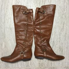 Carlos Santana Riding Boots Carlos Santana riding boots. Has a few scratches and scuffs that is common on real leather boots. Since having my baby my foot is a half size larger so I can no longer fit into these beauties  Carlos Santana Shoes Heeled Boots