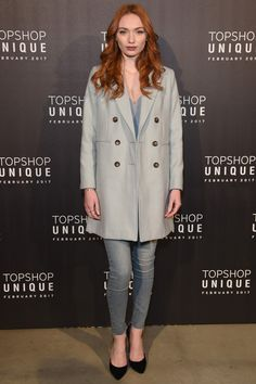 Eleanor Tomlinson wears a Double Breasted Coat, £59 MOTO Bleached Raw Hem Jamie Jeans, £40 Crackle Leather Belt, £22