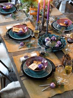 Creative christmas table setting in purple and turquoise