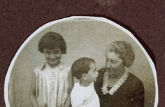 A portrait of Margot Frank, standing next to an elderly woman with Anne Frank on her lap, 1931. This was a page from Margot's photo album.