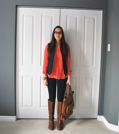 silk blouse, quilted vest, jegging, and brown riding boots