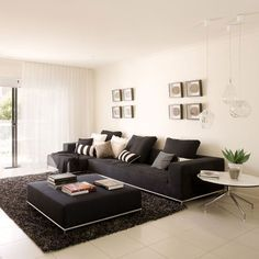 Living Room Decor Black Sofa living room. arch lamp beside the cozy black sectional sofa