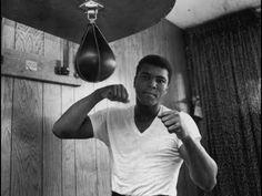 boxing legends hitting speed bag