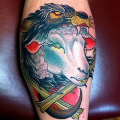 I like the design of this. The wolf mask/hat blends and disappears well in the design. I also like the use of american style tattoo on the wolf contrasting with the shading of the sheep.