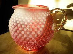 Cranberry hobnail glass pitcher