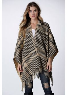 Timeless Plaid Poncho in Camel || A classy opened poncho. This poncho has plaid designs throughout and a fringe lined hemline. Super warm and super cute. Throw this over a long sleeved turtleneck, skinny jeans, and booties.