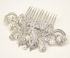 "This silver rhinestone and pearl bridal hair comb has vintage inspired detail. The intricate design of this headpiece is perfect for your romantic or classic wedding day look.   Measures approximately 4"" x 1 3/4""."