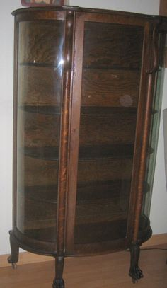 Antique  Bow Front Oak China Cabinet Claw Feet by vintagehouses