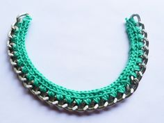 Love what I found at this website: Thanks, I Made It: DIY Crochet Necklace