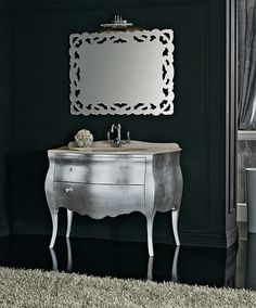 Beautiful silver chest used as a bathroom vanity.