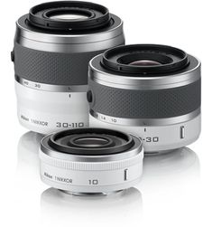 Just when I thought I knew what camera I wanted, Nikon comes out with an interchangeable lens point and shoot.