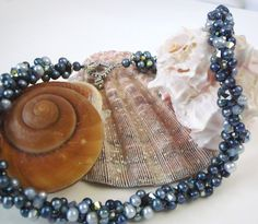 Denim blue Swarovski crystal and fresh water pearl kumihimo woven necklace.  Just stunning.