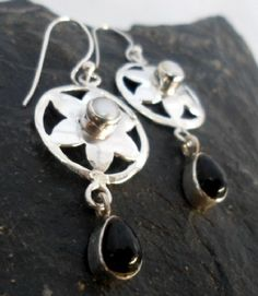 $34.00~Sterling Silver Flower Drop Earrings with Pearl and Black Onyx~Designed in India click on the picture or following link for all details: http://www.silverjewelry-sterling.com/earringsindia/Sterling-Silver-Flower-Pearl-Black-Onyx-Earrings.html#.UWclQ6ZvCVg