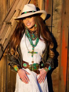 Western hat, leather jacket, white cotton dress, vintage green turquoise, stacked necklaces, leather belt,