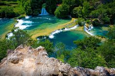 Krka National Park, Croatia, was declared as a national park in 1985 (river Krka flows in the park). It is situated in central Dalmatia, north-east of the city of Šibenik in Croatia. There's an Entrance fee and swimming is allowed on the lower parts natural amazing pools of the park. All over the park there are fantastic scenic lakes, beautiful turquoise water and a large number of of waterfalls.  Photos by Kate Pedley: http://www.flickr.com/photos/38381877@N00