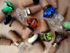 Screw decorative door knobs into wine corks to make custom wine stoppers! Add a bottle of wine and you have a great hostess gift!     G.T.
